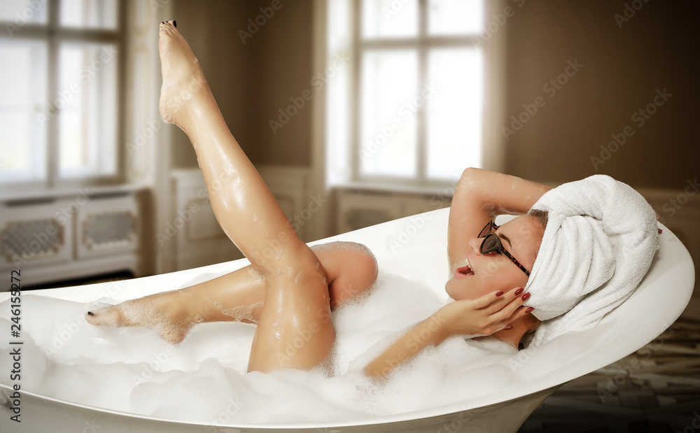 Fototapeta Luxury interior and slim young woman in white bath.