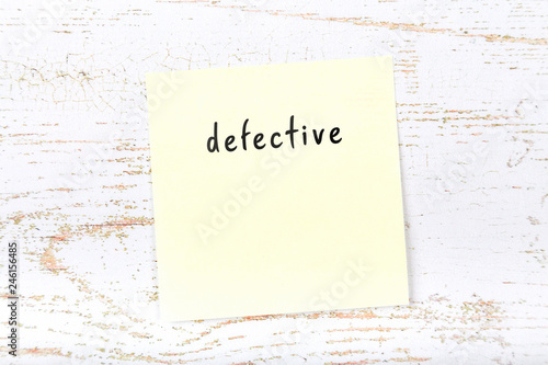Fotografia, Obraz  Yellow sticky note with handwritten text defective