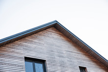 New House With Wooden Facade And New Roof