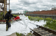 The Firefighter Shows Work Of System Of Foamy Suppression.