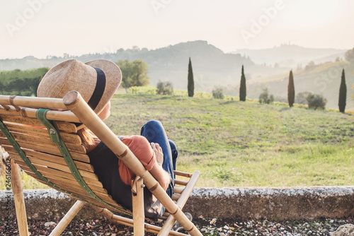 Foto op Plexiglas Toscane Enjoying life. Young woman looking at the valley in Italy, relaxation, vacations, lifestyle, summer fun concept. Vacations in Italy