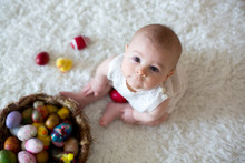 Cute Little Toddler Baby Boy, Playing With Colorful Easter Eggs And Little Decorative Ducks, Isolated Shot