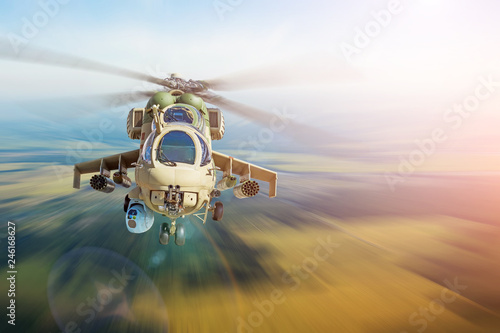 Military combat helicopter flies at high speed, territory patrol guards.