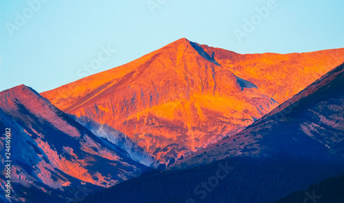 Canvas Prints Red High mountains peak on the first rays of the sunrise, fresh morning. Sunset at the alpine mountain heights.