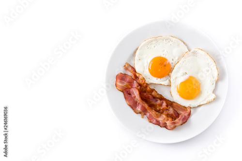 Fried eggs and bacon for breakfast isolated on white background. Top view. Copyspace