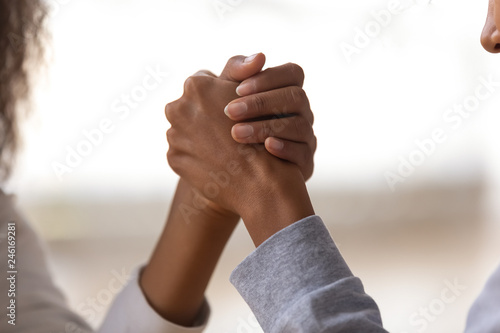 Fotografie, Obraz  Close up of mom and daughter holding hands showing unity, support and understand