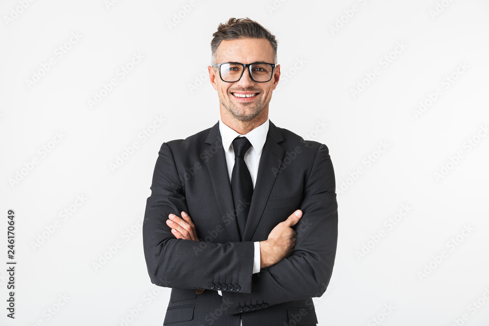 Fototapety, obrazy: Handsome business man isolated over white wall background posing.