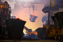 Copper Production At The Metallurgical Plant. Large Industrial Structures, Ore Buckets, Cranes And Workers. Indoors A Lot Of Fumes As A Result Of Smelting Metal.