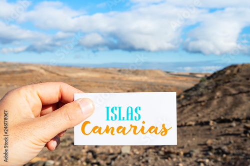 Fotografia  text Canary Islands in signboard in dry landscape.