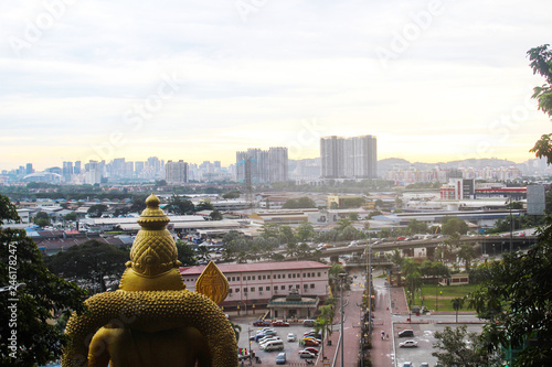 Evening View on Kuala Lumpur skyline with golden statue from batu caves temple, Wallpaper Mural