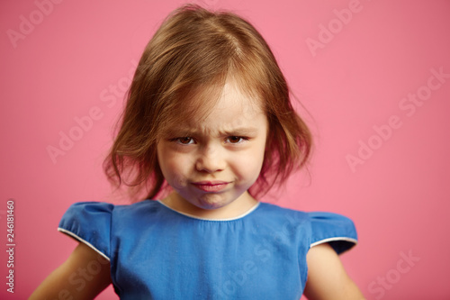 Vászonkép  Portrait of sad little girl on isolated pink.