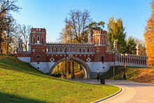 Figured Bridge In Tsaritsyno Park In Moscow On A Blue Sky Background At Sunny Autumn Day