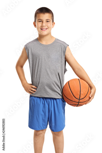 Smiling boy posing with a basketball