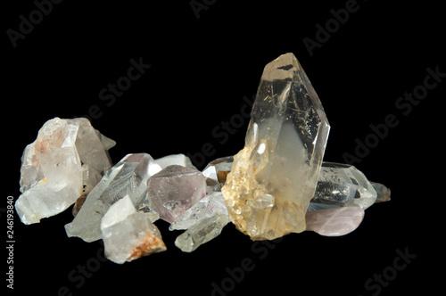 Numerous large clear quartz crystal points on black background, surface level and up close on black background Tapéta, Fotótapéta