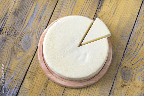 Photo  Traditional cheesecake on the wooden table