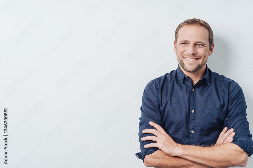 Fototapety, obrazy: Young man with a thoughtful pleased smile