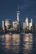 New York City business district skyline at dusk, color toning applied, USA.