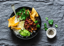 Burrito Rice Bowl With Tortilla Chips, Cilantro And Avocado On Grey Background, Top View