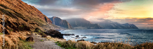 Poster de jardin Gris Sunset from Kaena Point on the west coast of Oahu, Hawaii on a cloudy day