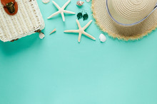 Tropic Flat Lay With Straw Hat, Bag, Starfish, Shells, Sunglasses, Boat, Earrings On Green Background. Summer Fashion Flat Lay, Vacation, Travel Concept. Top View With Copy Space.