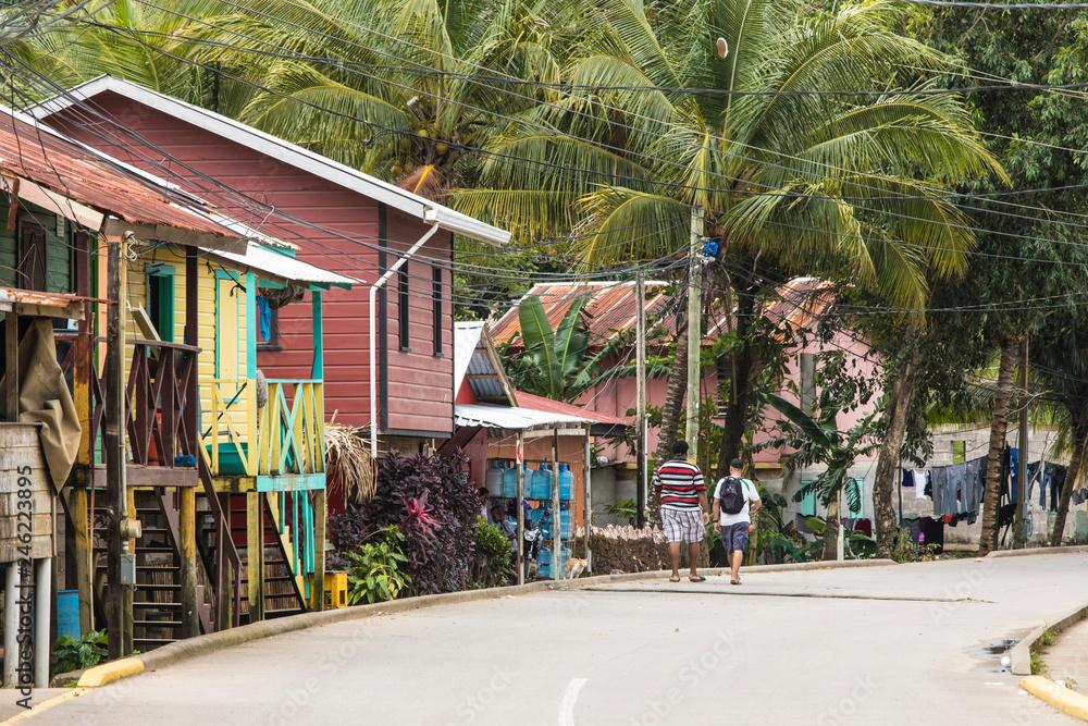 Fototapeta People walk down the streets of the Garifuna village of Punta Gorda, Honduras.
