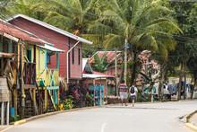 People Walk Down The Streets Of The Garifuna Village Of Punta Gorda, Honduras.