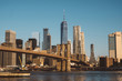 Brooklyn Bridge over East River against clear sky during sunny day