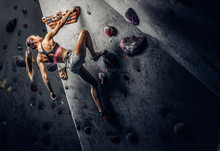 Young Sporty Woman Climbing Ar...
