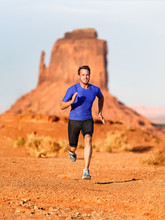 Runner. Running Man Sprinting In Monument Valley. Athlete Runner Cross Country Trail Running Outdoors In Amazing Nature Landscape. Fit Male Sports Model In Fast Sprint At Speed, Arizona Utah, USA.