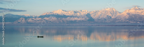 Beautiful scenic landscape  of Shkodra lake, mountains reflection and a little f Canvas Print
