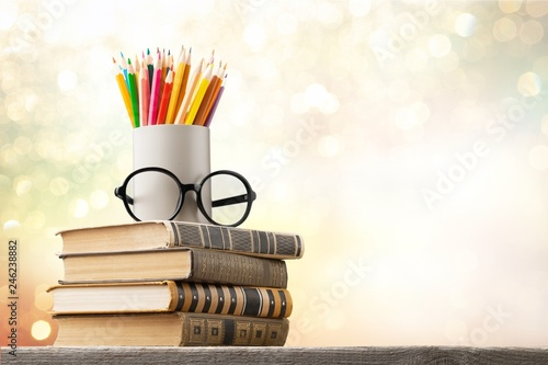 Stack of vintage books, eyeglasses and pencils, education and Fototapete