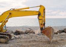 Yellow Excavator On The Seasho...