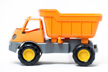 Plastic Toy Yellow Truck On A White Background. Close-up.