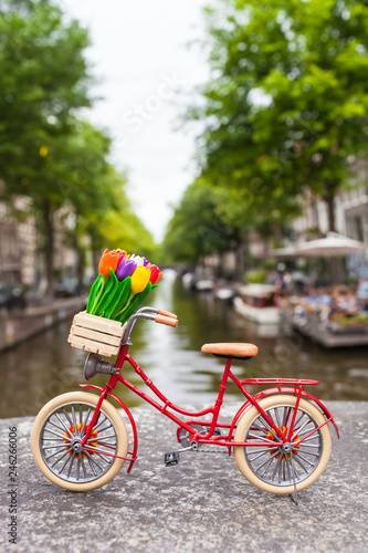 Photo Colorful Amsterdam Spring City Bike Trip / Red dutch miniature bicycle with cute