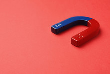 Red And Blue Horseshoe Magnet On Color Background. Space For Text