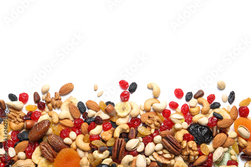 Poster Fruit Different dried fruits and nuts on white background, top view. Space for text