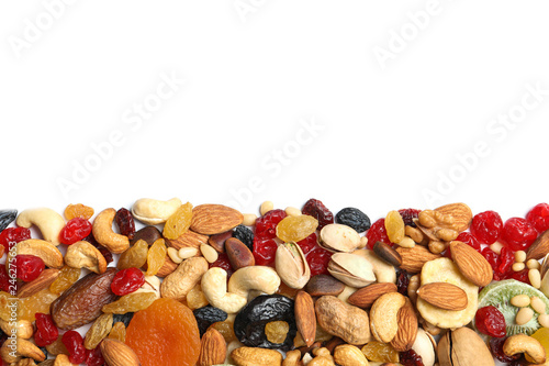 Different dried fruits and nuts on white background, top view. Space for text