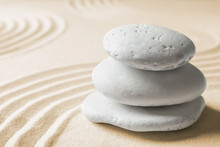 Stacked Zen Garden Stones On Sand With Pattern, Space For Text. Meditation And Harmony