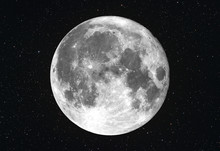 Bright Super Moon With Stars As Backround In The Deep Space. Composition Of Two Photos Taken With Telescope.