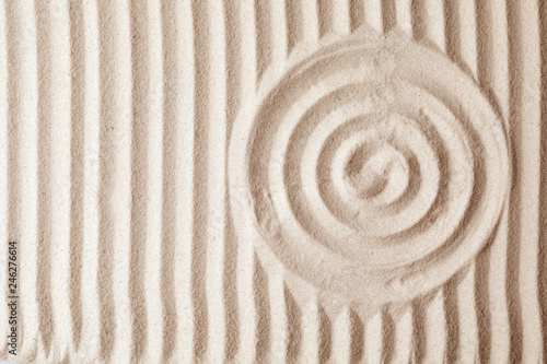 Recess Fitting Zen Zen garden pattern on sand as background, top view. Meditation and harmony