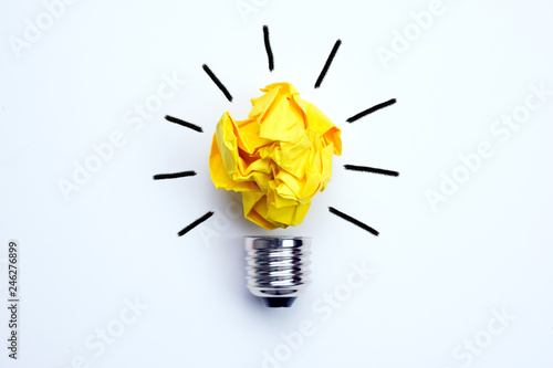 Obraz Great idea concept with crumpled yellow paper light bulb isolated on white background - fototapety do salonu