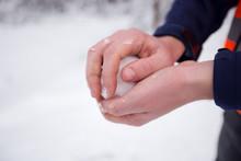 Hands Holding Fresh Snow, Man Making Snowball