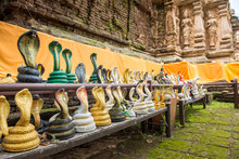 A Lot Of Snake Statue Around The Base Of Pagoda In Wat Jed Yod Temple Of Chiang Mai Province Of Thailand. People Acknowledge It As The Temple For Those Who Were Born In Year Of The Small Snake.