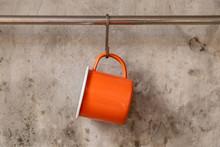 Orange Tin Cup Hanging On Stai...