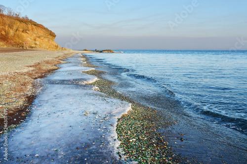 Glass beach in Steklyannaya Bay near Vladivostok. Russia, Primorsky Krai, in december in evening