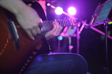 Closeup Guitarist Playing. Men...