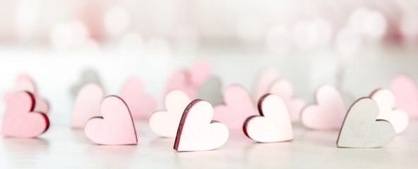 Backround or banner for valentines day, mothers day with hearts and bokeh in light pink