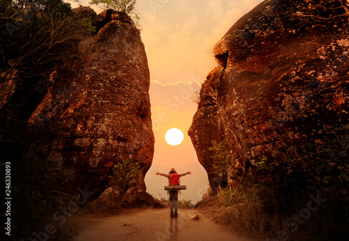 Woman standing and open hand on sunset or sunrise background