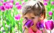 Leinwandbild Motiv Danger in a vase. face skincare. allergy to flowers. Small child. Natural beauty. Childrens day. Little girl in sunny spring. Summer girl fashion. Happy childhood. Springtime tulips. weather forecast