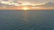 sun rising at sea horizon aerial shot